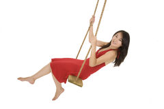 Asian woman playing in wooden swing Stock Photo