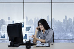 Asian accountant working with virtual financial charts Stock Photos