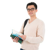 Asian adult student with books Royalty Free Stock Image