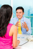 Asian advisor with client on financial investment Stock Photography