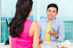 Asian advisor with client on financial investment Royalty Free Stock Image