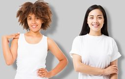 Asian and african american girl in blank template t shirt isolated on gray background. Women in tshirt with copy space and mock up stock photo