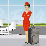 Asian air hostess posing with luggage in front of an airport observation deck Stock Image