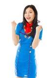 Asian air stewardess celebrating success Stock Photo