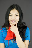 Asian air stewardess with hand on chin Royalty Free Stock Photo