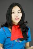 Asian air stewardess looking shocked Royalty Free Stock Image
