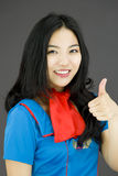 Asian air stewardess making thumbs up sign Stock Photography