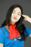 Asian air stewardess pointing finger to head Stock Images