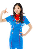 Asian air stewardess pointing at herself isolated over white background Royalty Free Stock Photography