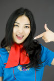Asian air stewardess pointing at herself Stock Photography