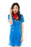 Asian air stewardess pointing up Royalty Free Stock Photos