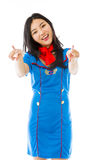 Asian air stewardess pointing at you from both hands isolated on white background Royalty Free Stock Photo