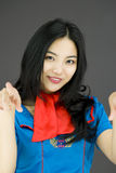 Asian air stewardess pointing at you from both hands Royalty Free Stock Images