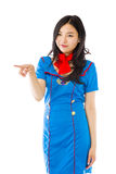 Asian air stewardess pointing Royalty Free Stock Photography