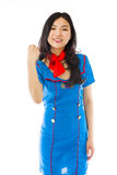 Asian air stewardess punches fist into the air isolated on white background royalty free stock photos