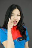 Asian air stewardess scolding someone Royalty Free Stock Photography