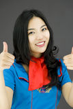 Asian air stewardess showing thumbs up from both hands Stock Images