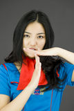 Asian air stewardess showing timeout signal Royalty Free Stock Image