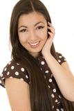 Asian American beauty wearing brown polka dot dress smiling Royalty Free Stock Image