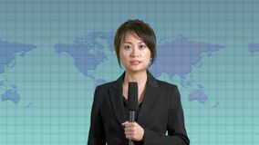 Female news anchor in studio. Asian American female news anchor in studio with map background, TV news concept stock video