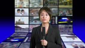 Female news anchor in studio stock footage