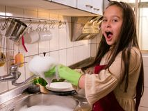 Asian  American girl washing dishes Stock Photos
