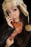 Asian American girl wearing winter clothes looking forward into Royalty Free Stock Photos