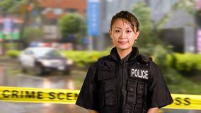 Asian American Police Officer Smiles at Camera stock image
