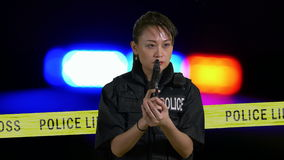 Asian American Policewoman with a pistol stock video