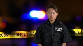 Asian American Policewoman smiling at camera Stock Photo