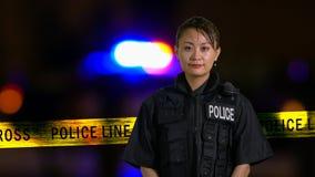 Asian American Policewoman smiling at camera Stock Photos