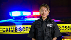 Asian American Policewoman smiling at camera Royalty Free Stock Images