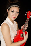 Asian American teen beauty holding her red ukulele Royalty Free Stock Image
