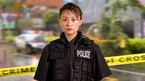 Asian American Woman Police Officer at Crime scene royalty free stock image