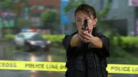 Asian American police officer at crime scene stock footage