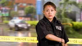 Asian American Woman Police Officer at Crime scene royalty free stock photos