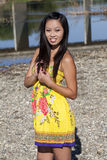 Asian American Woman Standing Outdoors Yellow Dress Royalty Free Stock Photography
