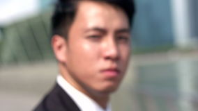 Asian angry young professional in slow motion stock footage