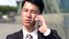 Asian angry young professional in slow motion stock video