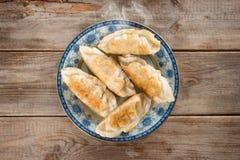 Asian appetizer pan fried dumplings Royalty Free Stock Photos