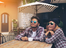 Asian and Arabic students couple in cafe Royalty Free Stock Photos
