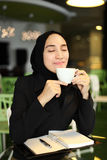 Asian Arabic Worker in a cafe Royalty Free Stock Photo