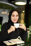 Asian Arabic Worker in a cafe Stock Photo