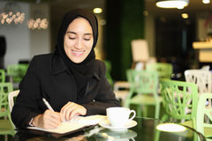 Asian Arabic Worker in a cafe Stock Images