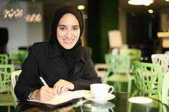 Asian Arabic Worker in a cafe Stock Image