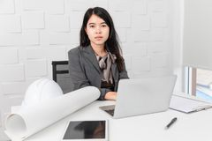 Asian architect at construction site office royalty free stock photos