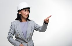 Asian Architect Engineer 50s 60s years old woman. Beautiful Asian Smart Architect Engineer 50s 60s years old woman in white hard hat helmet point fingers hands stock image