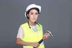 Asian Architect Engineer woman in white hard hat, safety vast, p Stock Image