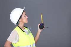 Asian Architect Engineer woman in white hard hat, safety vast, p Royalty Free Stock Image