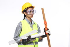 Asian Architect Engineer woman in yellow hard hat,  safety vast Royalty Free Stock Images